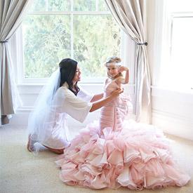 little girl in pink wedding dress | weddinggawker